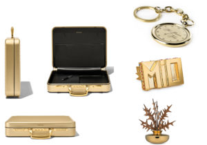 valigia gold Rimowa / orologio Tick Tock 'Illusion of Time' di Marcel Wanders per Starbucks / Complementi di arredo Alessi